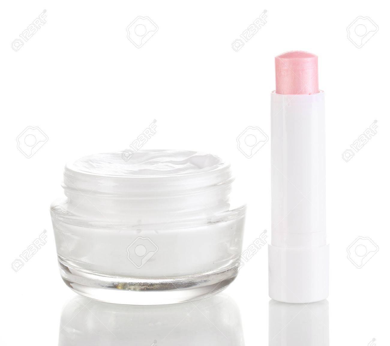 Hygienic lipstick and moisturizing cream isolated on white Stock Photo - 13375041