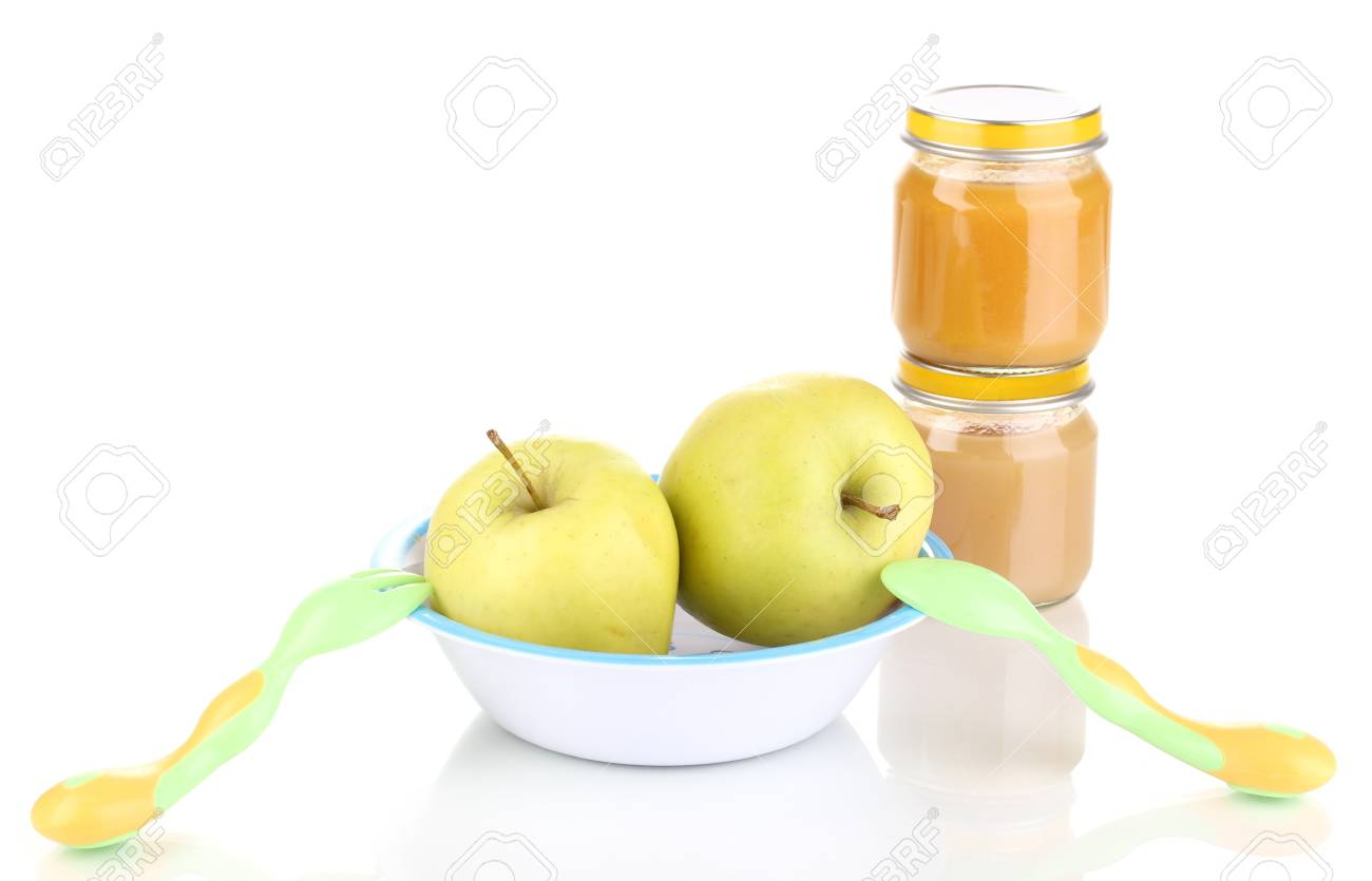 Jars of baby puree with plate, spoon and fork isolated on white Stock Photo - 13374946