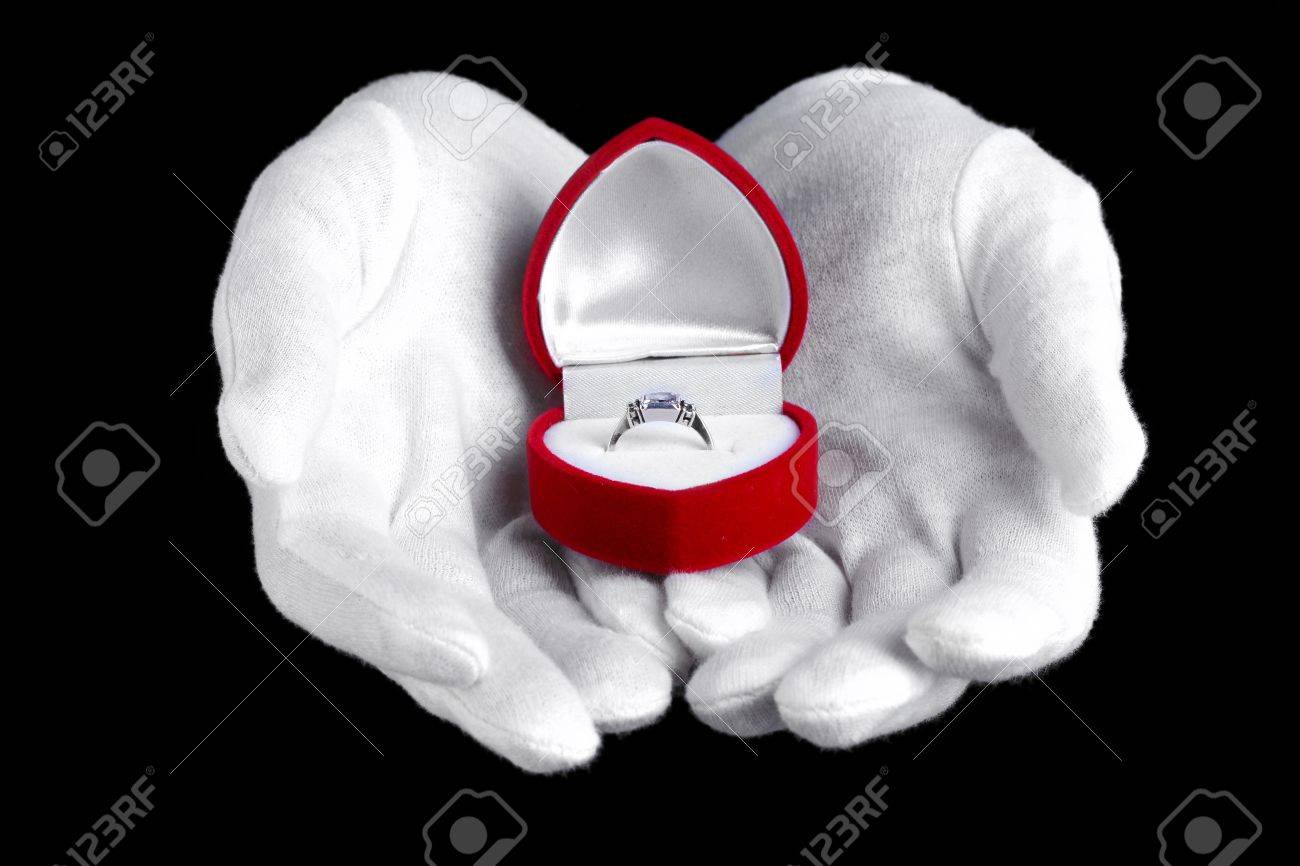Man's hands holding ring in box on black background Stock Photo - 13374262