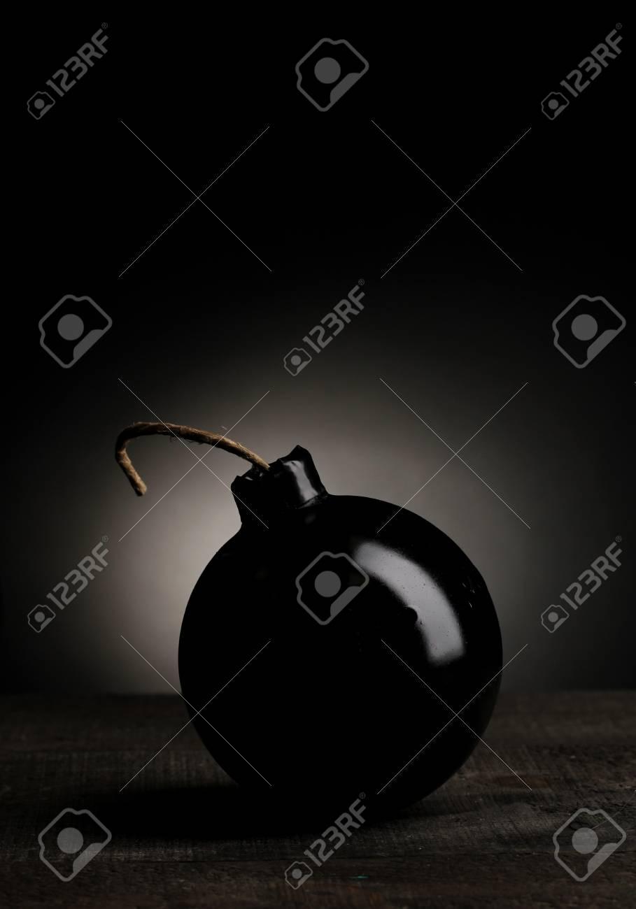 Cartoon style bomb on wooden table on black background Stock Photo - 13435254