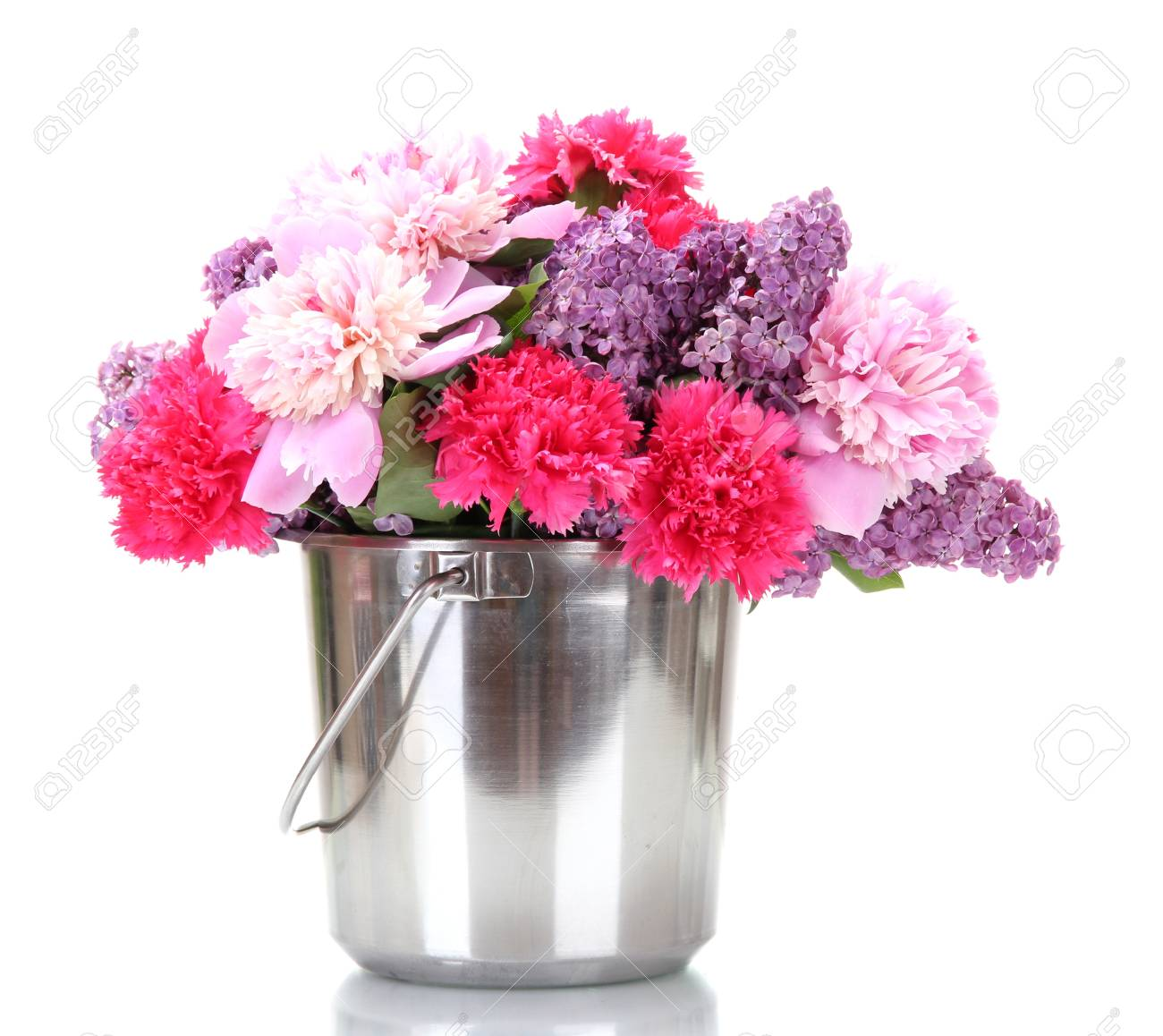 beautiful spring flowers in metal bucket isolated on white Stock Photo - 13581380