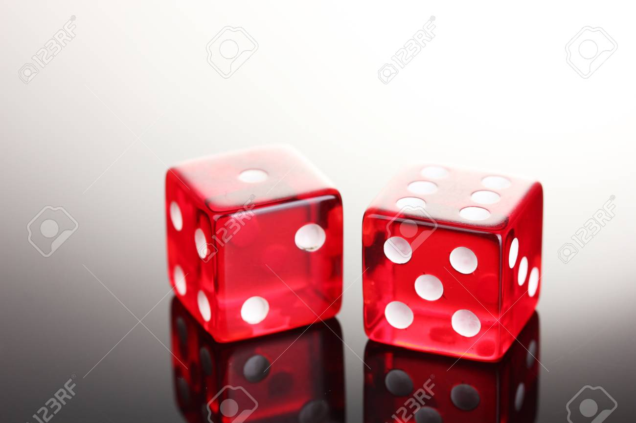 Red dices on grey background Stock Photo - 13791549