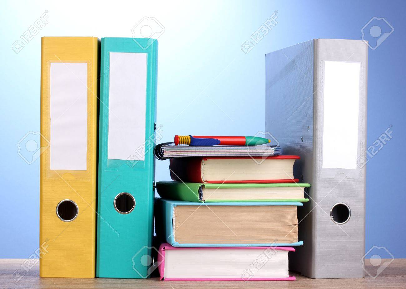 Bright Office Folders And Books With Stationery On Wooden Table ...