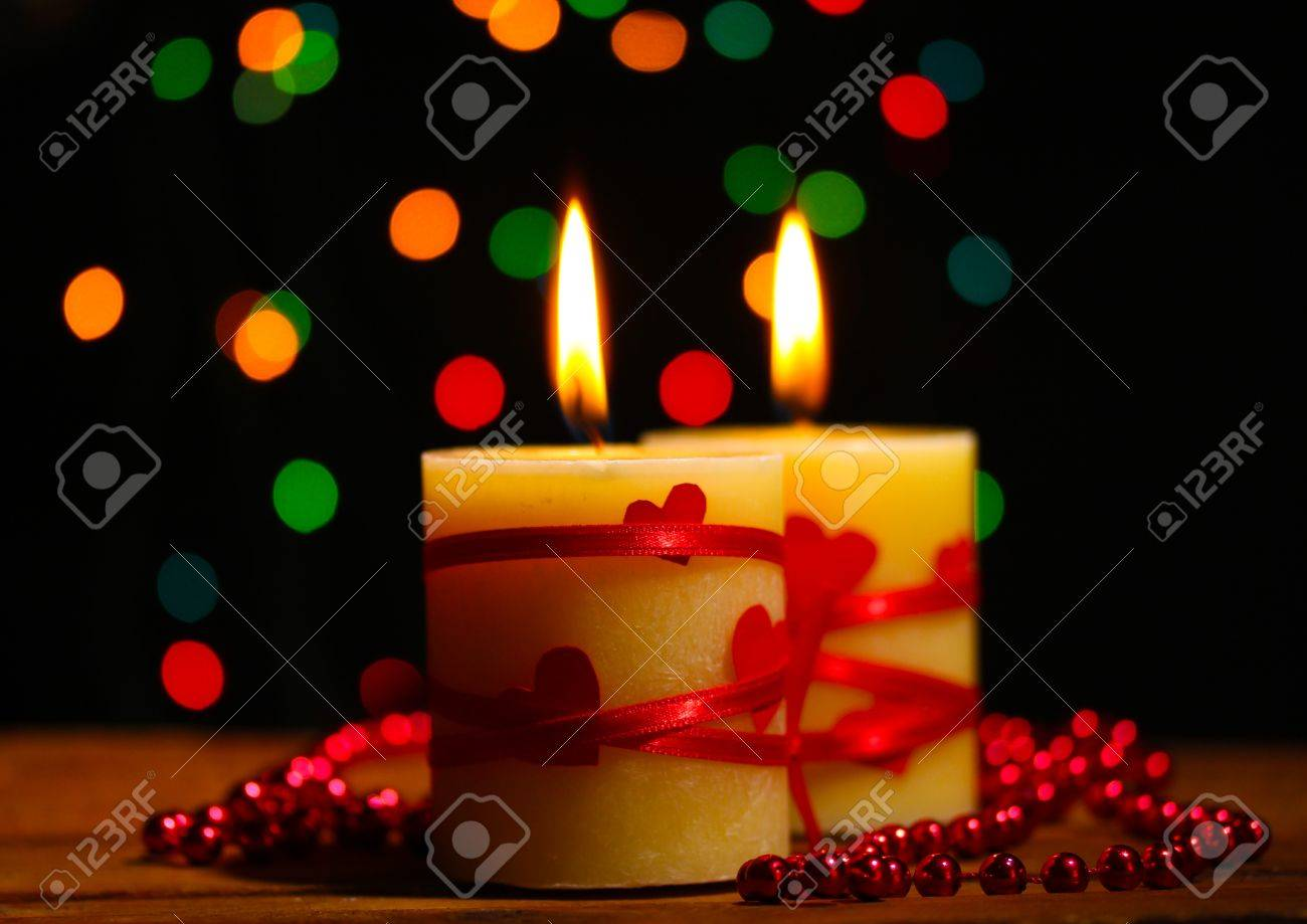 Beautiful candles on wooden table on bright background Stock Photo - 13818909