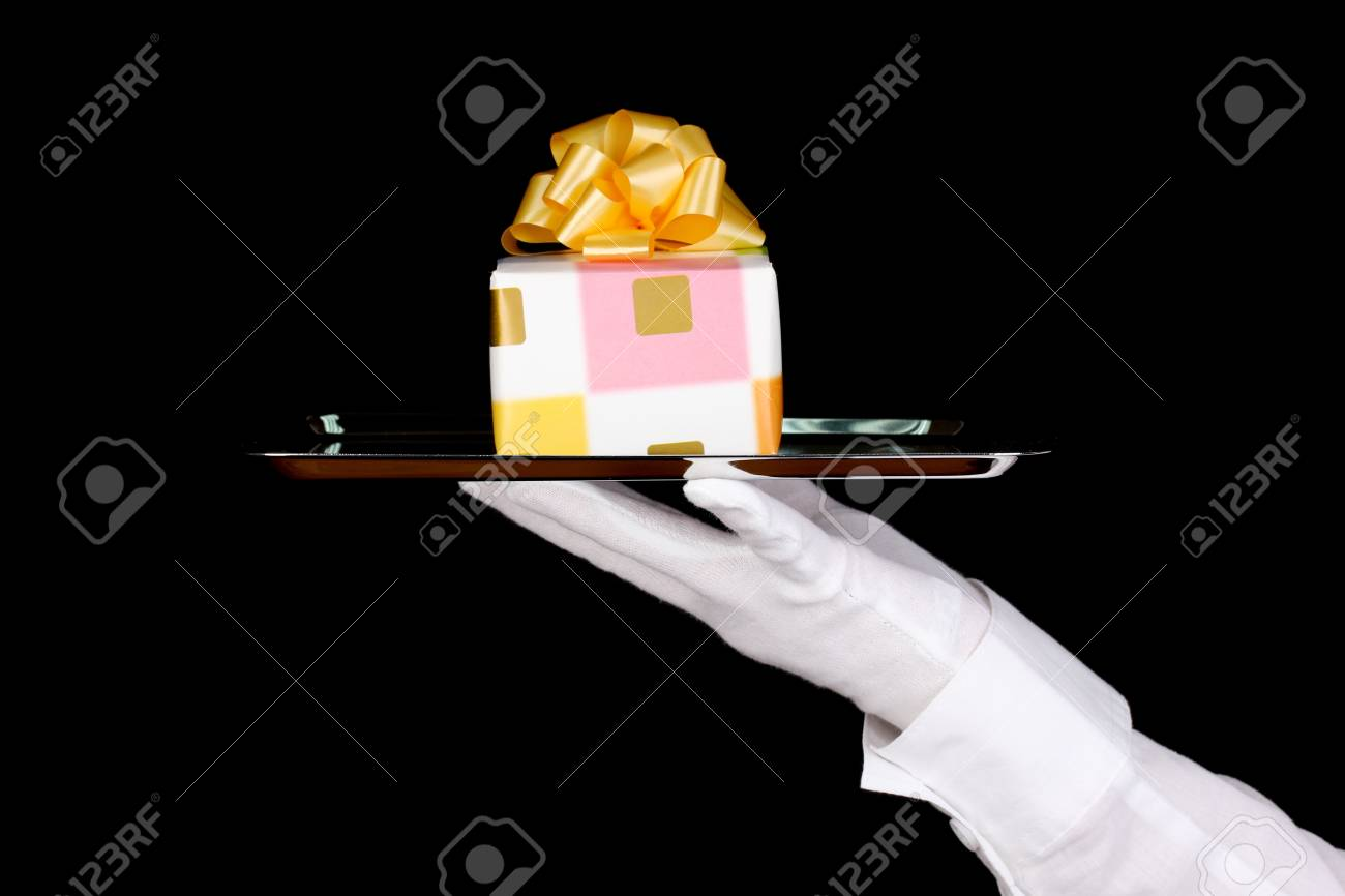 Hand in glove holding silver tray with giftbox isolated on black Stock Photo - 13818166