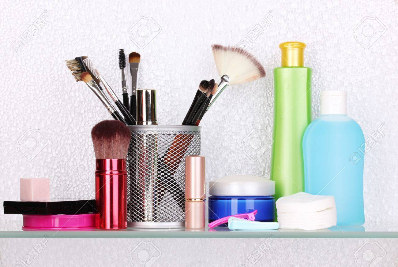 Shelf with cosmetics and toiletries in bathroom Stock Photo - 13820701