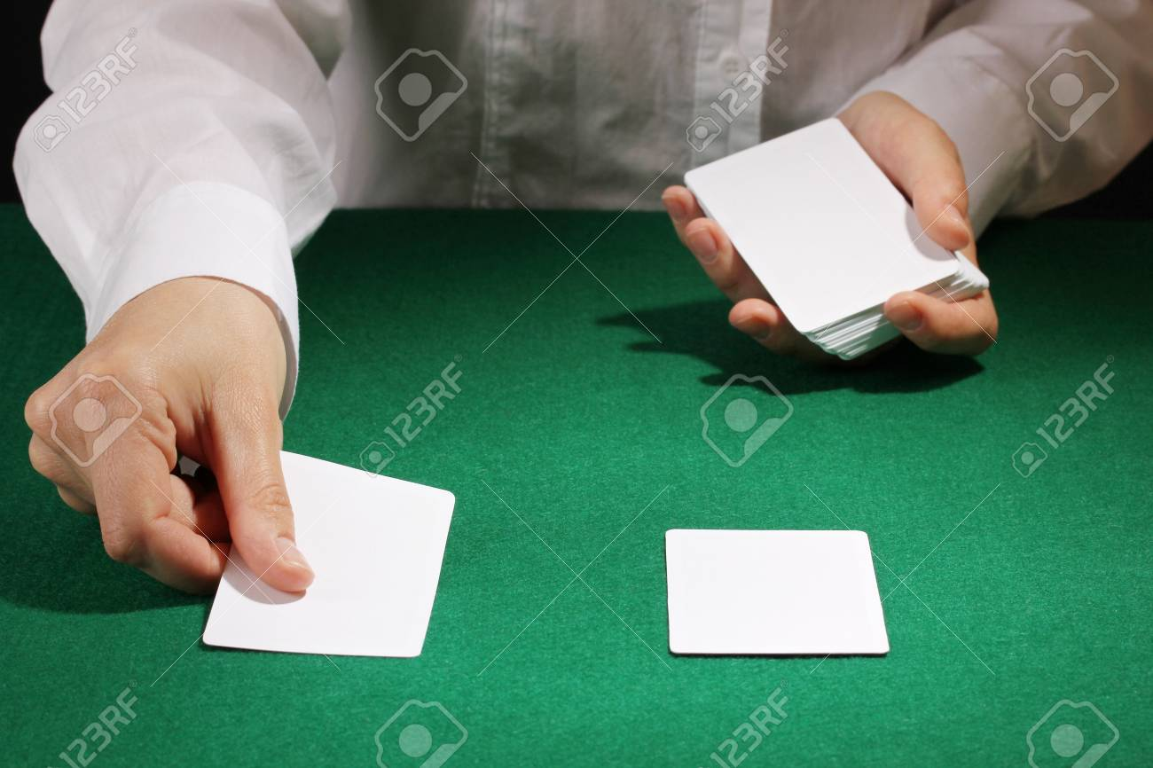 Cards in hands on green table Stock Photo - 13944610