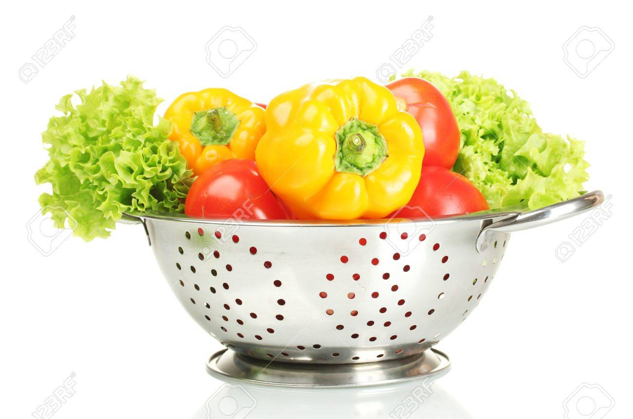 fresh vegetables in silver colander isolated on white Stock Photo - 13998205