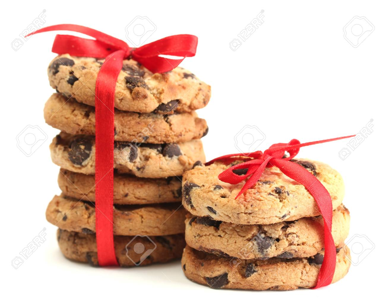 Chocolate chips cookies with red ribbons isolated on white Stock Photo - 14069677