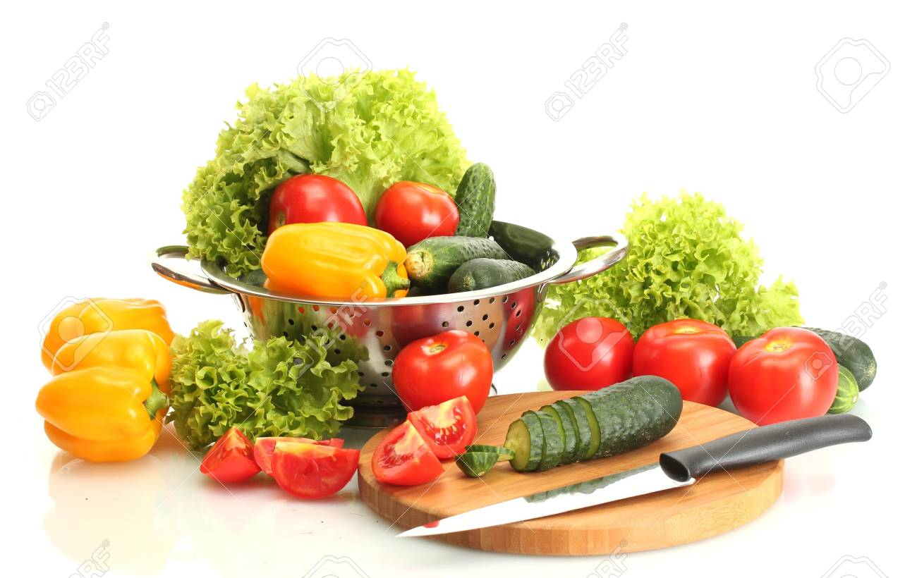 fresh vegetables and knife on cutting board isolated on white Stock Photo - 14077651