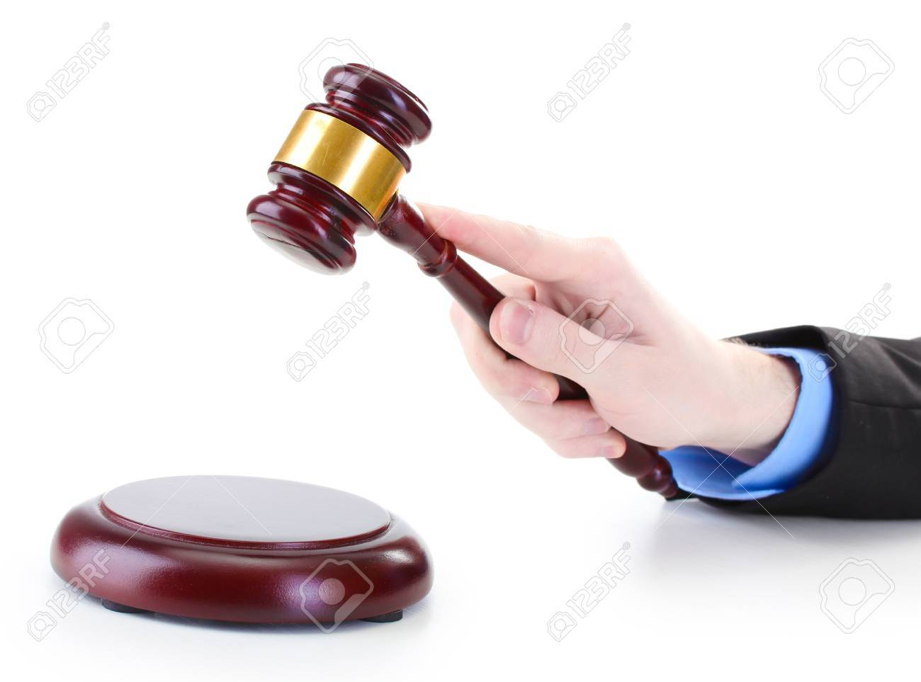 wooden gavel in hand isolated on white Stock Photo - 14077378