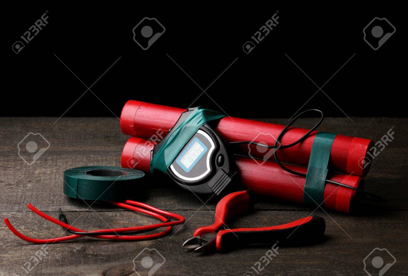 Making timebomb on wooden table on black background Stock Photo - 14098645
