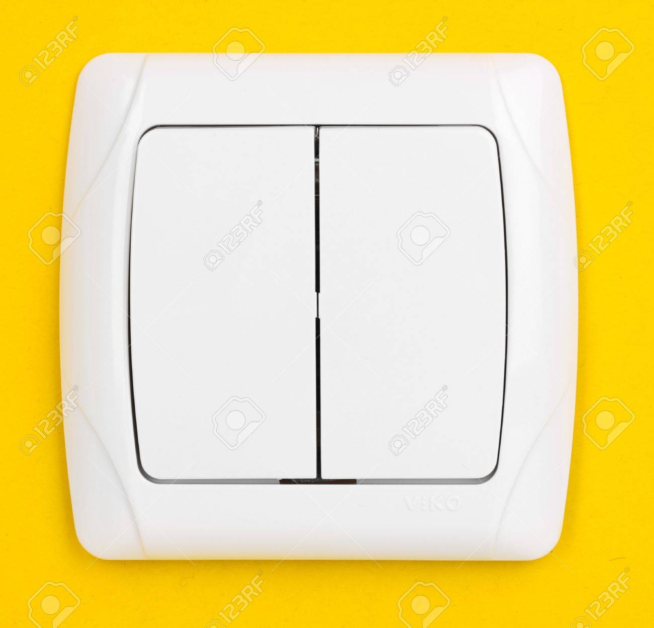 Modern light switch on yellow background Stock Photo - 14098206