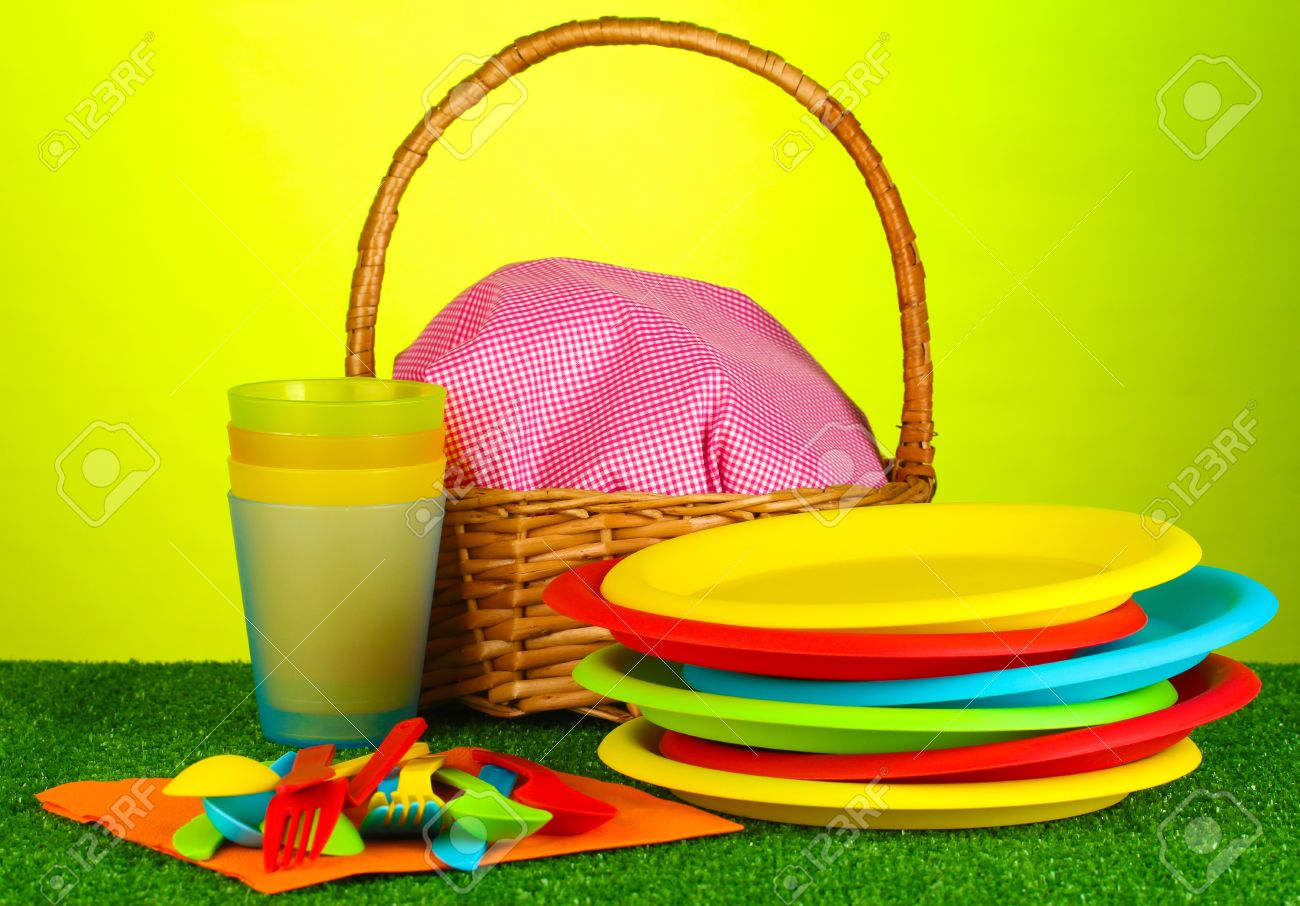 bright plastic disposable tableware and picnic basket on the lawn on colorful background Stock Photo - & Bright Plastic Disposable Tableware And Picnic Basket On The.. Stock ...