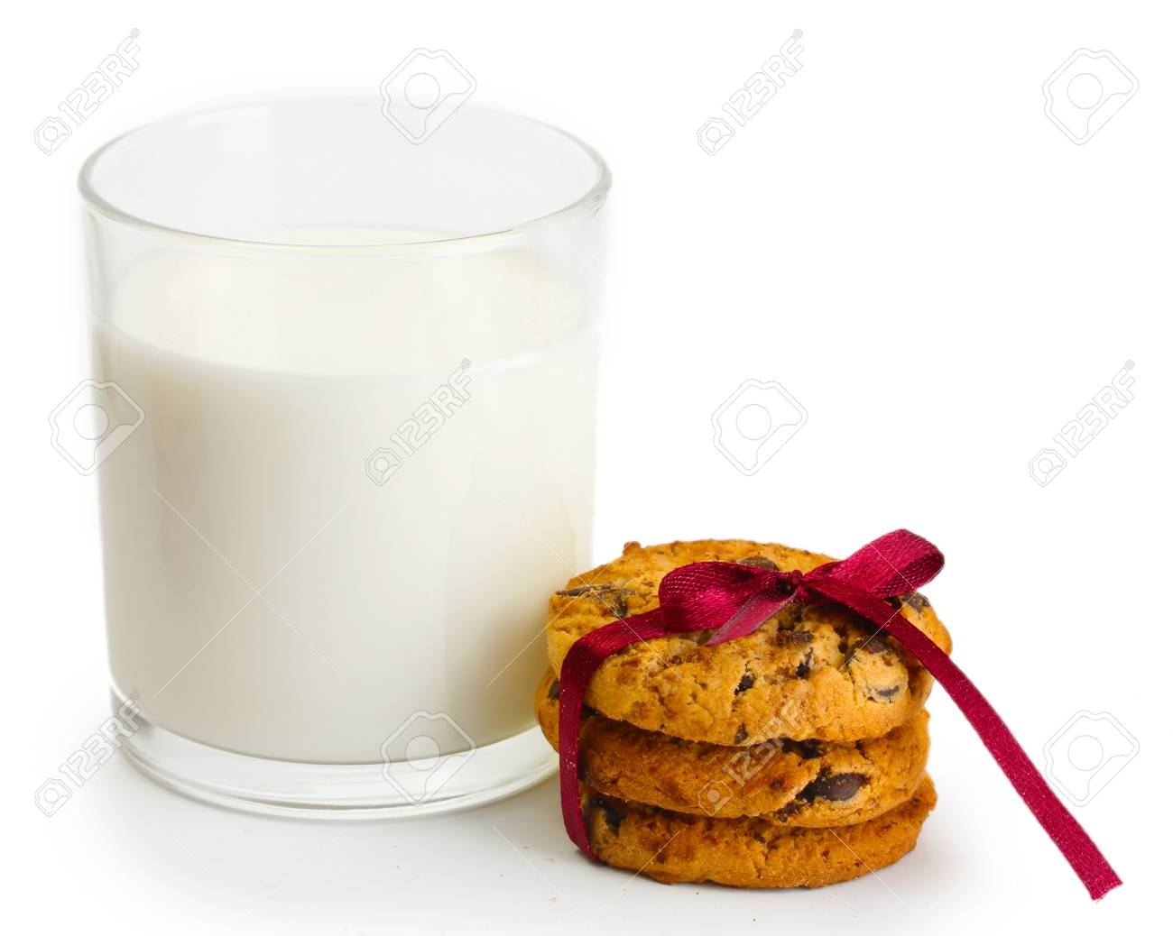 glass of milk and chocolate chips cookies with red ribbon isolated on white Stock Photo - 14169673