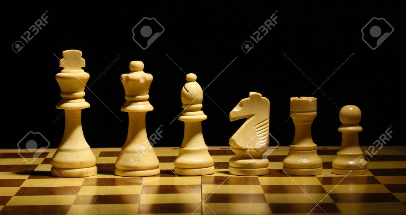 Chess board with chess pieces isolated on black Stock Photo - 14162139