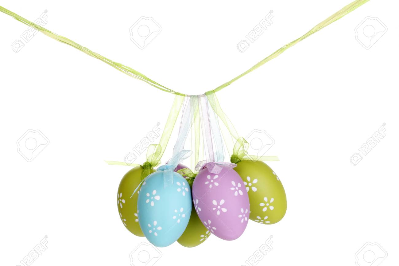 Colorful easter eggs hanging on ribbons isolated on white Stock Photo - 14354899