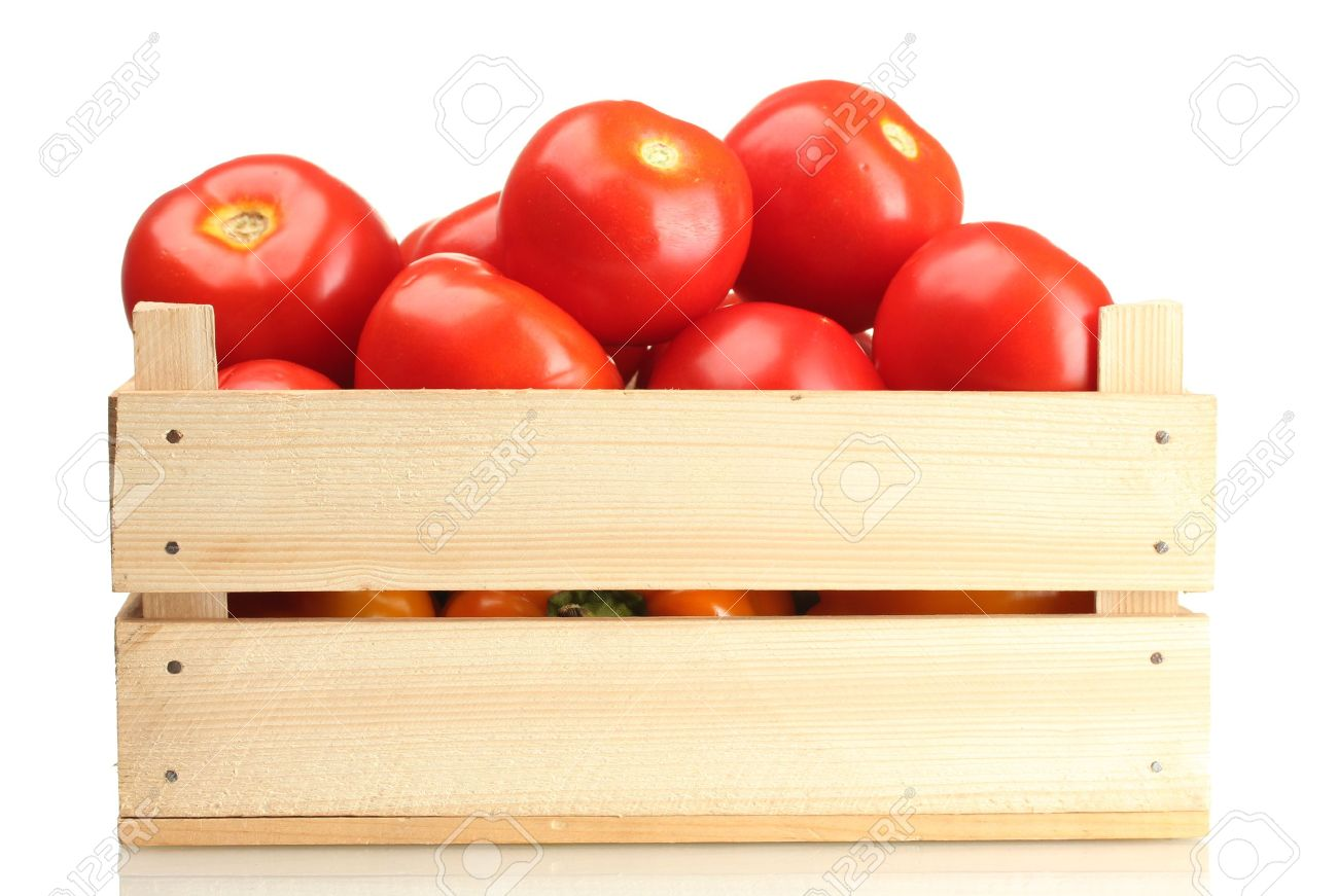 Ripe red tomatoes in wooden box isolated on white Stock Photo - 14437174