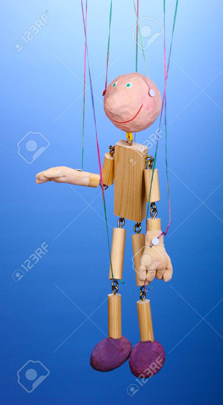 Wooden puppet on blue background Stock Photo - 14454547