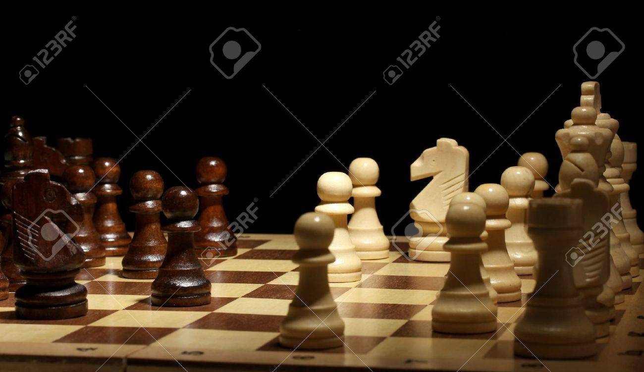 Chess board with chess pieces isolated on black Stock Photo - 14486232