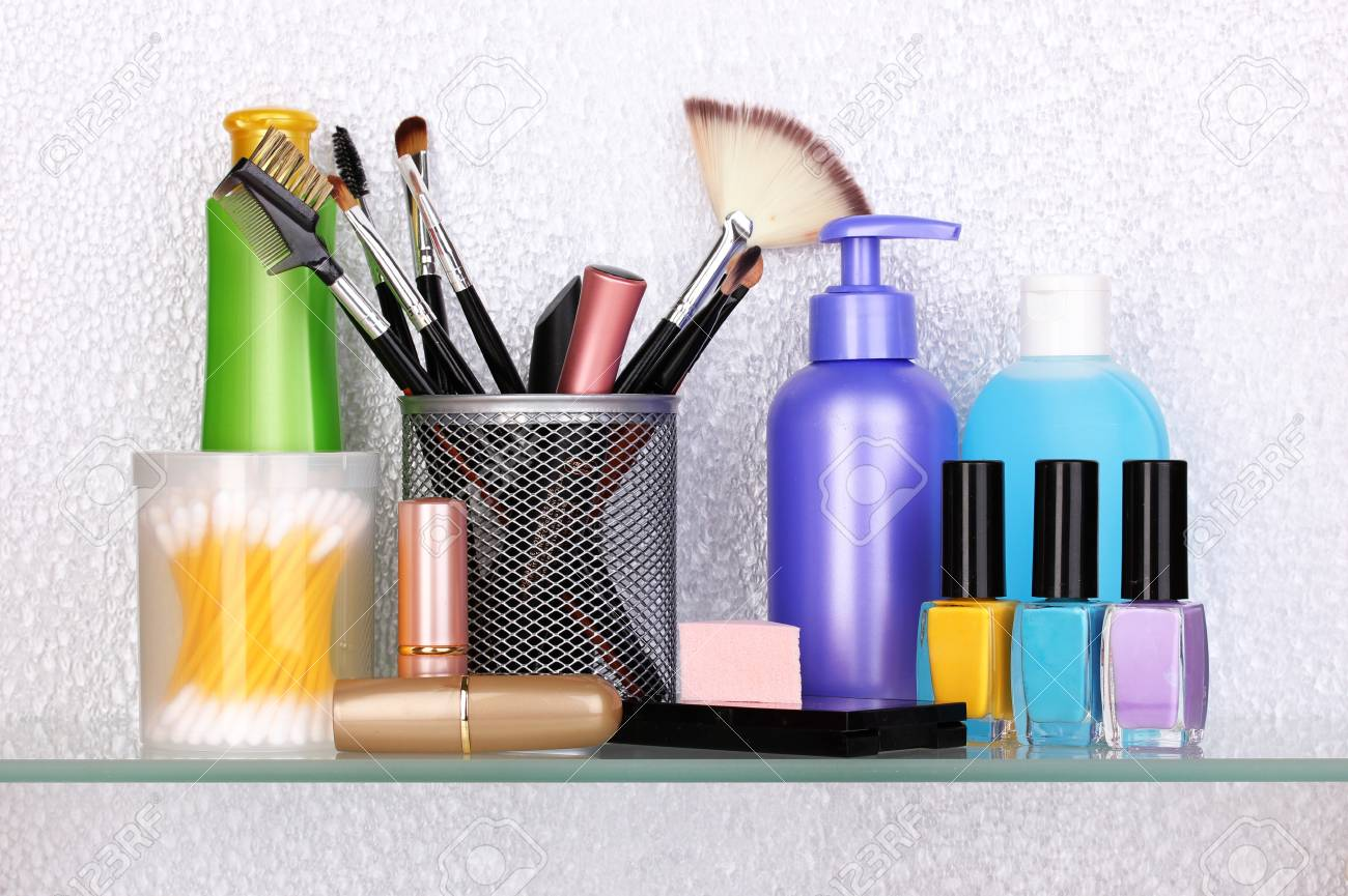 Shelf with cosmetics and toiletries in bathroom Stock Photo - 14703944