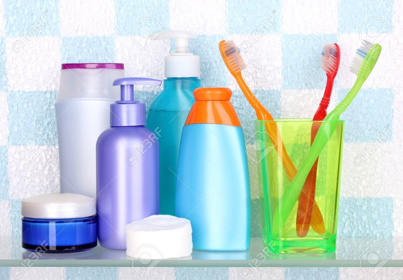 Bathroom Toiletries shelf with cosmetics and toiletries in bathroom stock photo