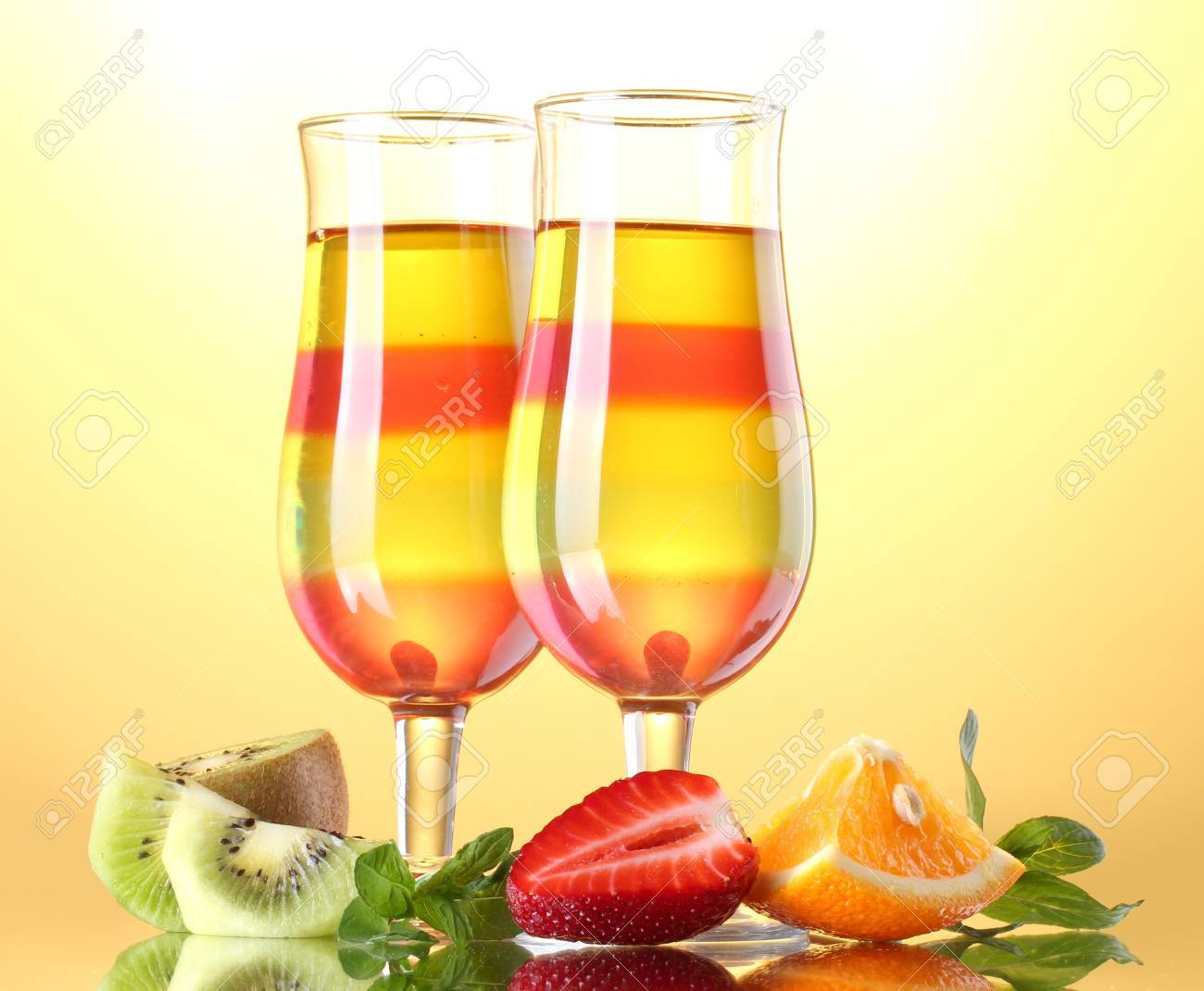 fruit jelly in glasses and fruits on yellow background Stock Photo - 14739287
