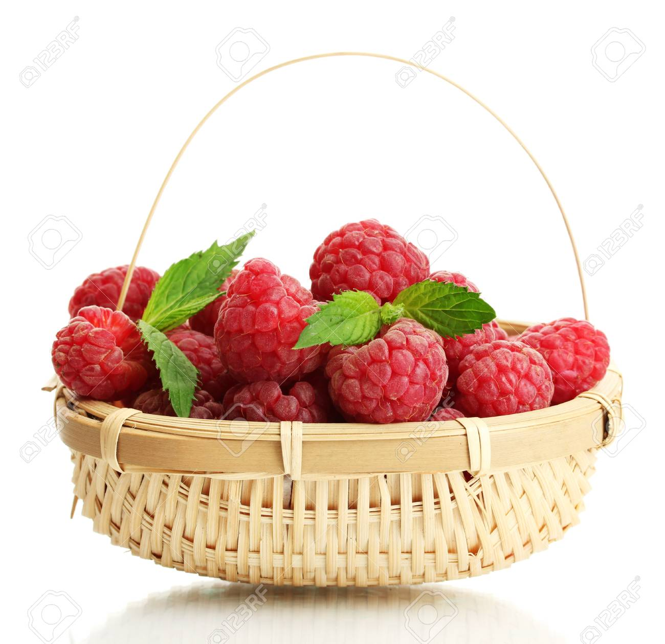 ripe raspberries in basket with mint  isolated on white Stock Photo - 14837753