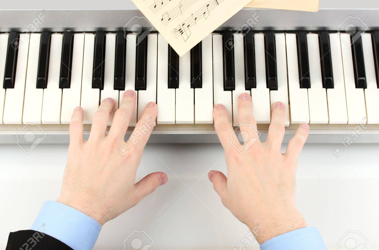 hands of man playing piano Stock Photo - 14921626
