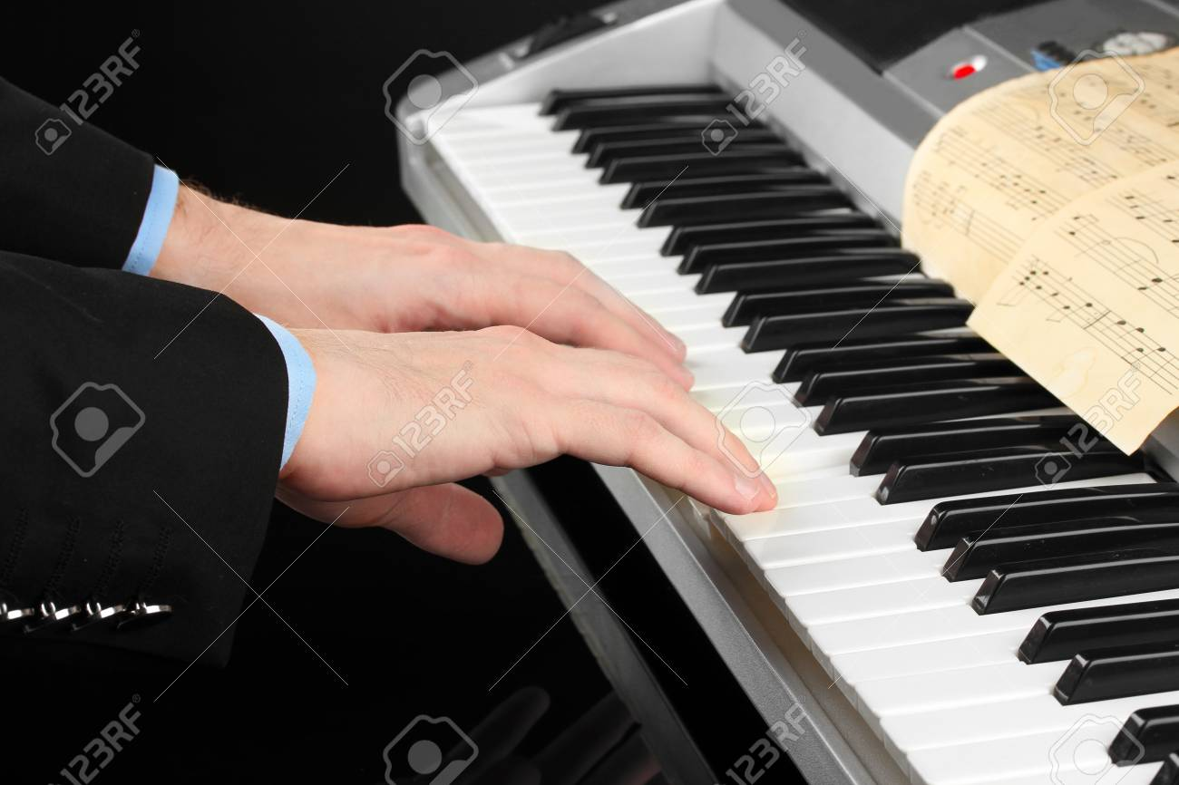 man hands playing piano Stock Photo - 15015185