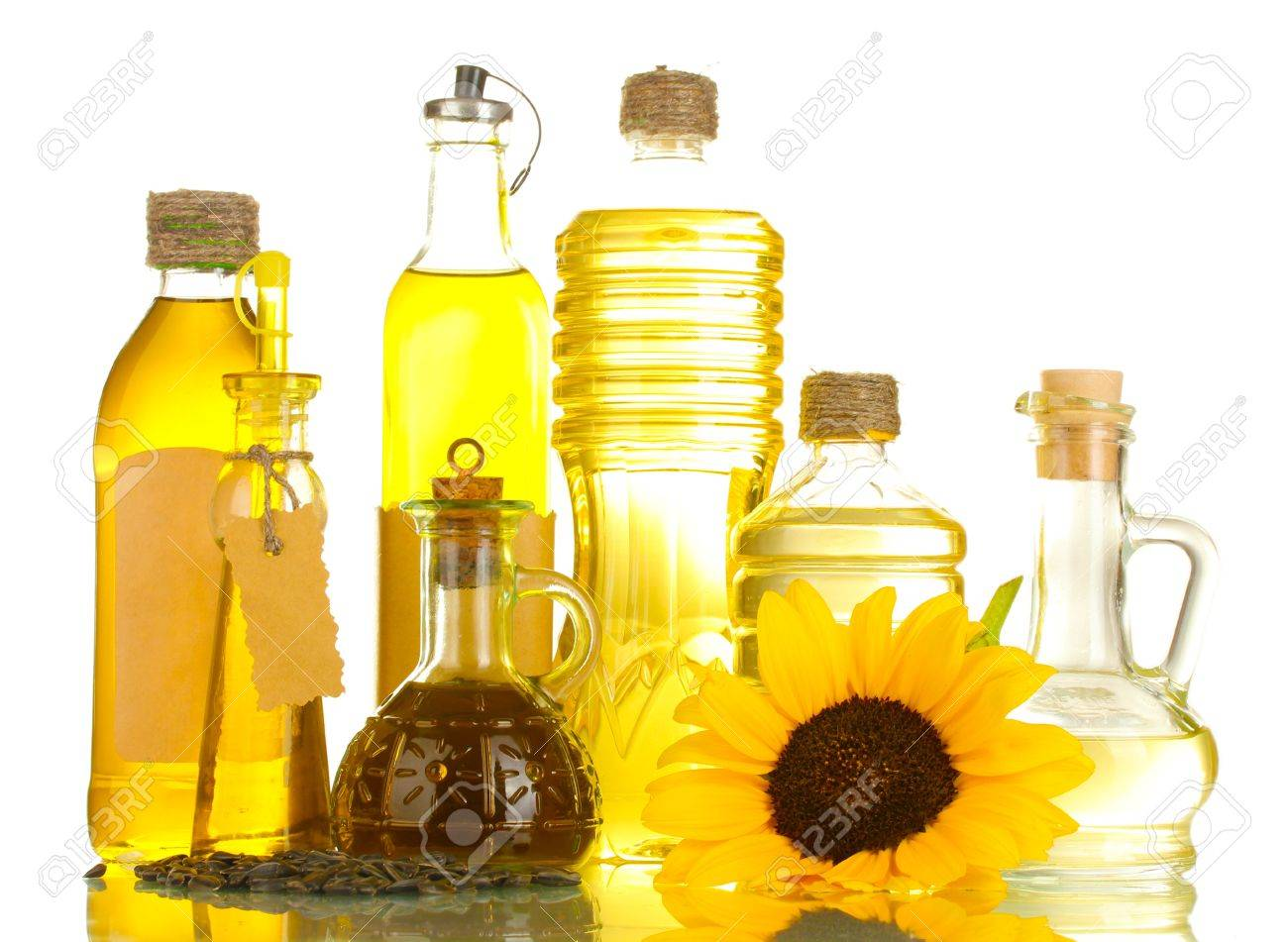 oil in bottles, sunflower and seeds, isolated on white