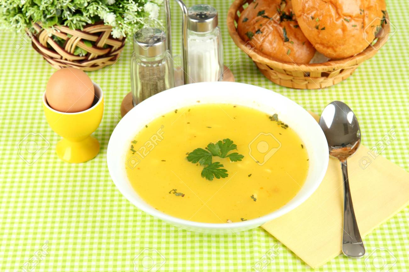Fragrant soup in white plate on green tablecloth close-up Stock Photo - 15545801