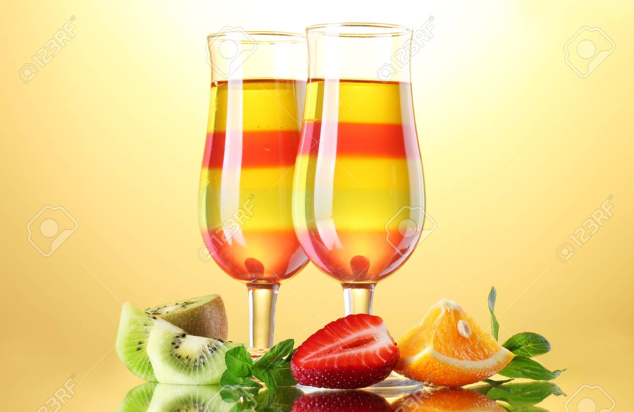 fruit jelly in glasses and fruits on yellow background Stock Photo - 15545905