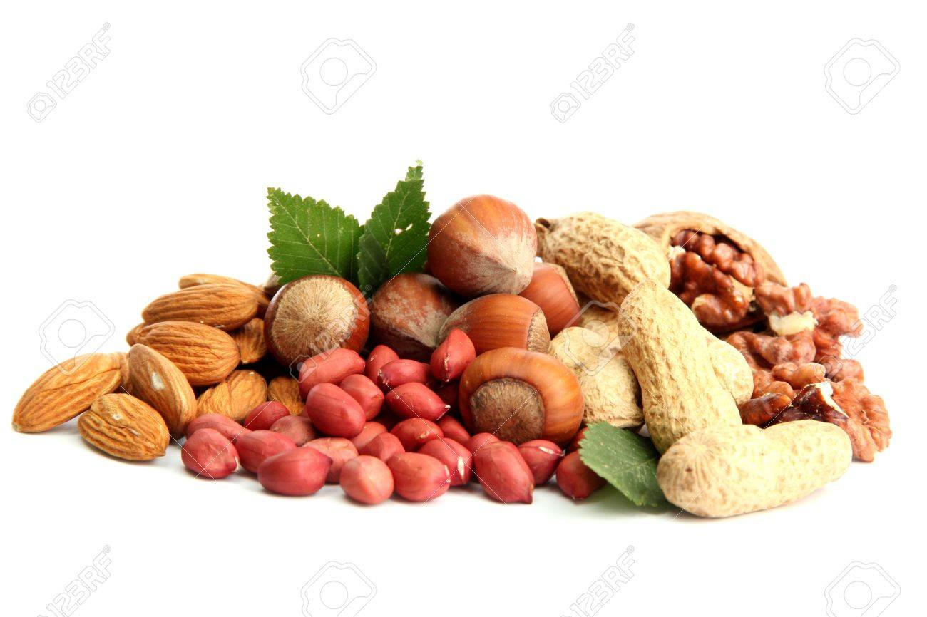assortment of tasty nuts with leaves, isolated on white Stock Photo - 15643333