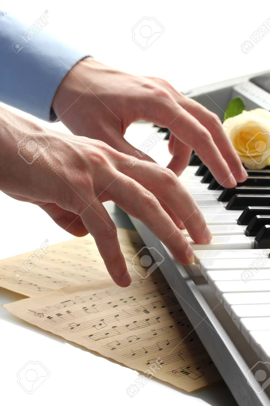 hands of man playing piano Stock Photo - 15726683