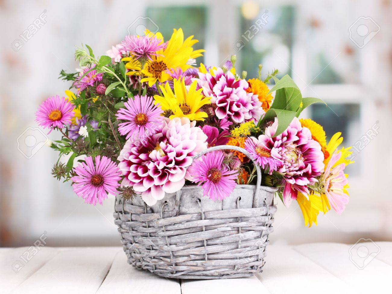 Beautiful Bouquet Of Bright Flowers In Basket On Wooden Table Stock ...