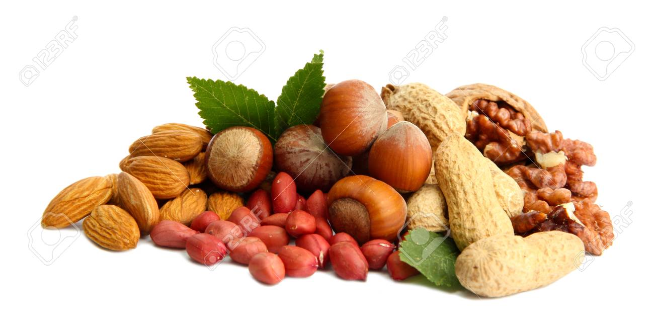 assortment of tasty nuts with leaves, isolated on white Stock Photo - 15725019