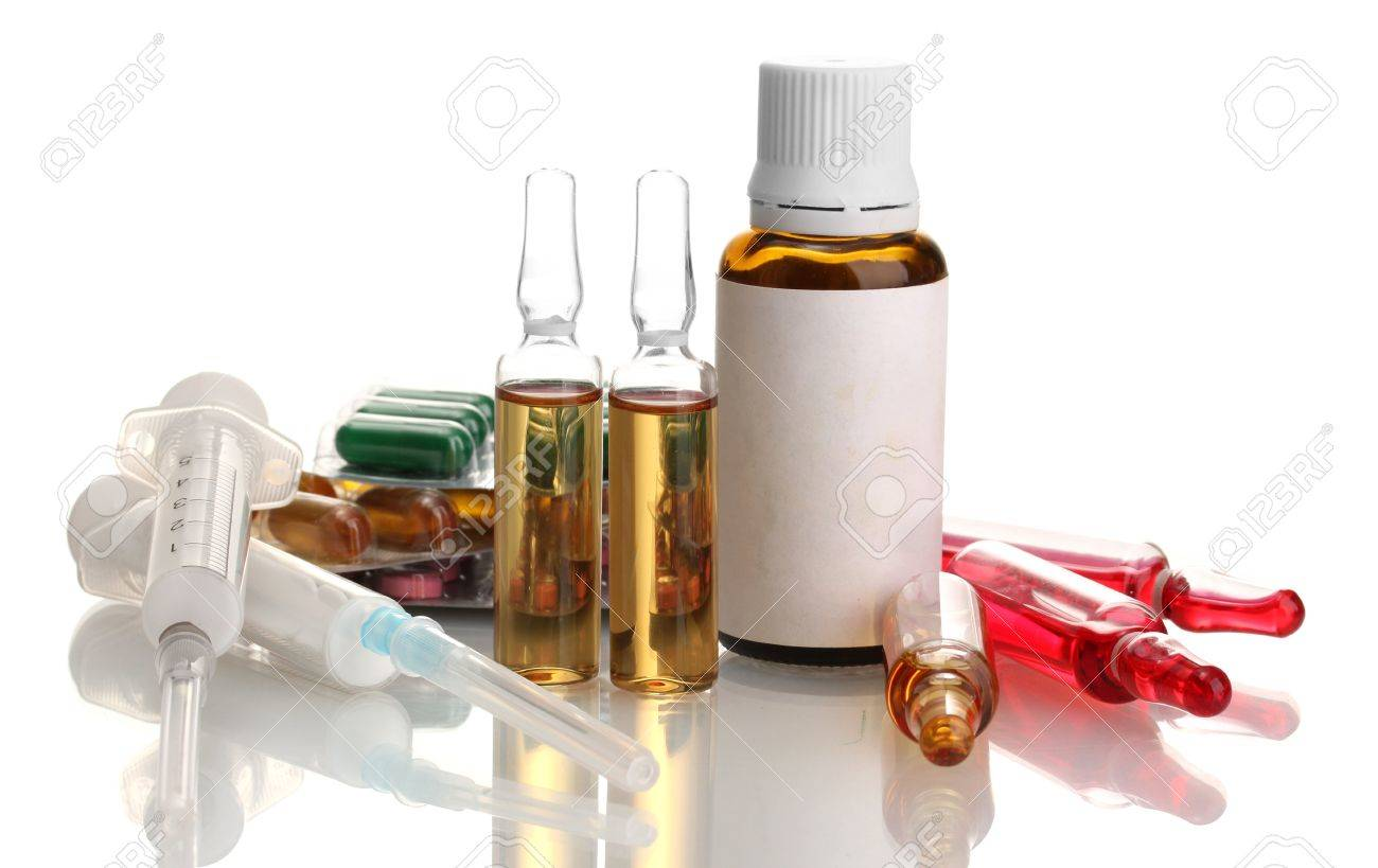 medical ampules, bottle, pills and syringes, isolated on white Stock Photo - 15724551