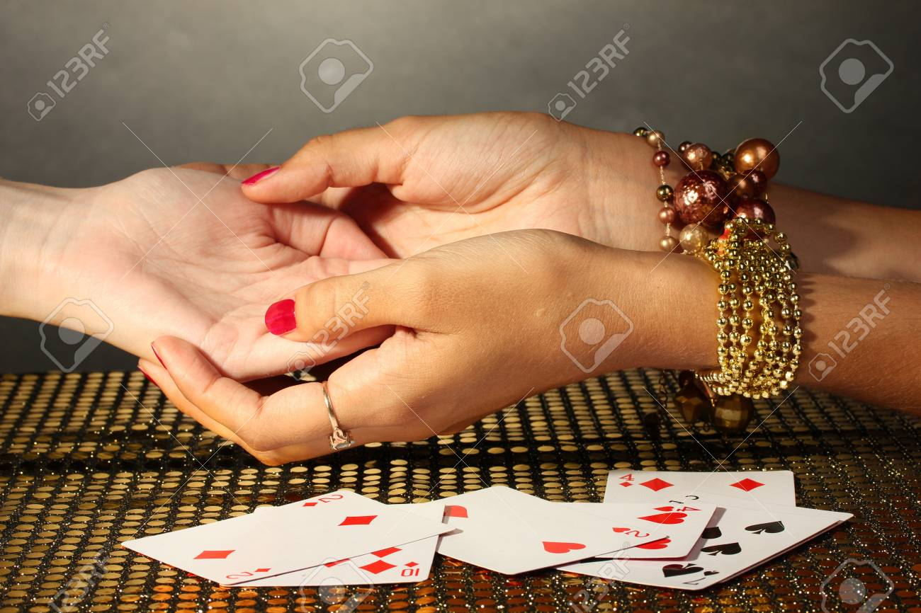 reading the lines hand in a woman's hands on grey backcground Stock Photo - 15748140
