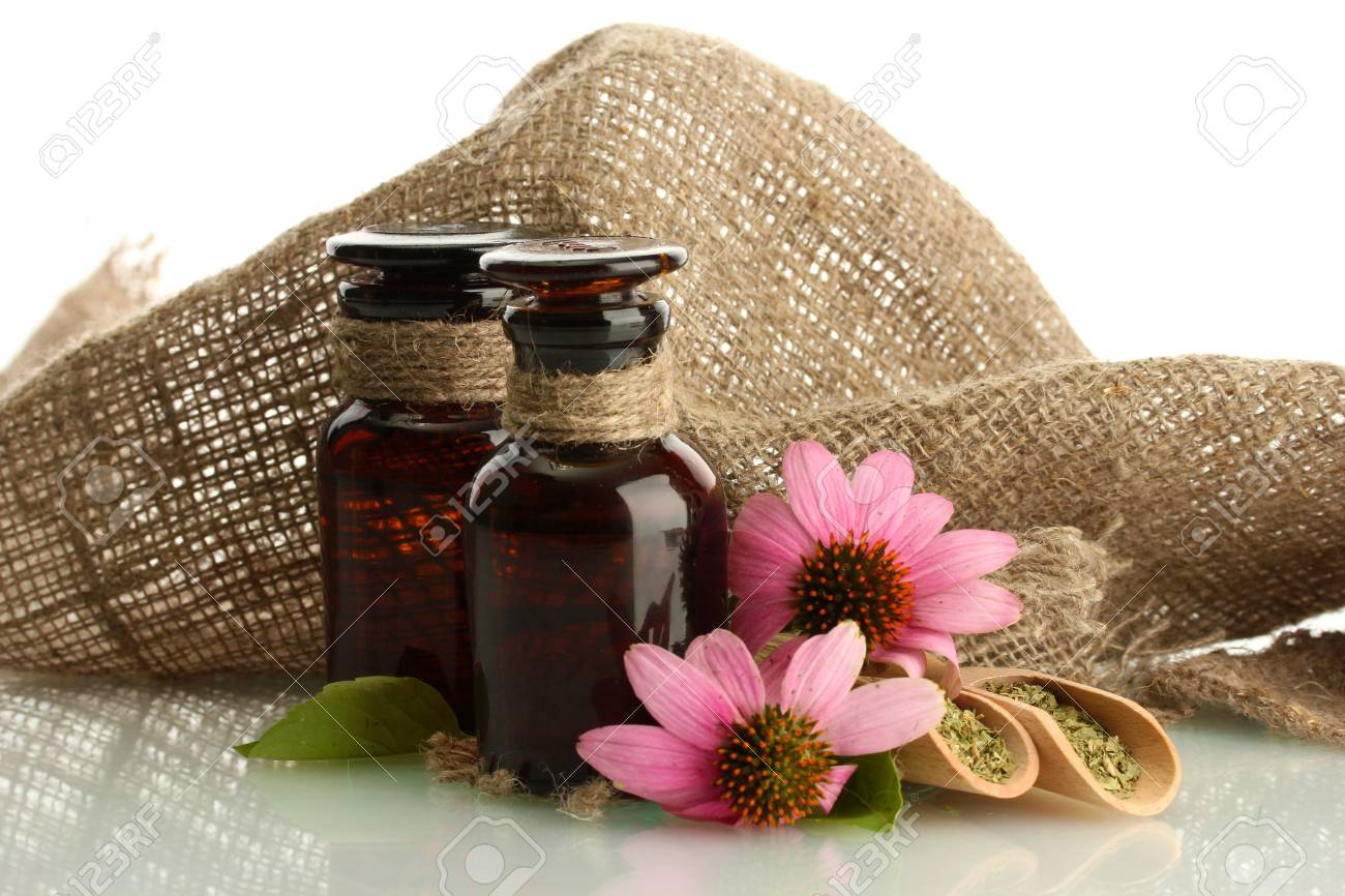 medicine bottles with purple echinacea , isolated on white Stock Photo - 15747985