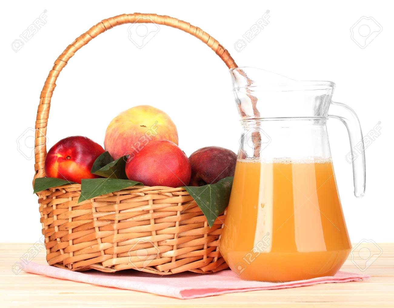 Ripe peaches in basket and juice on wooden table on white background Stock Photo - 15781512