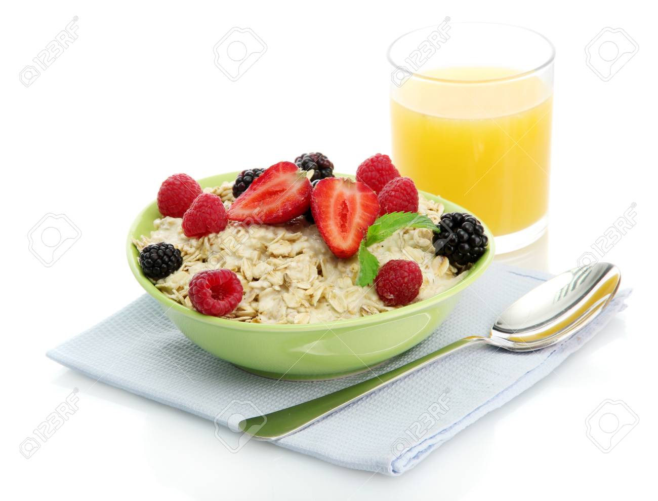 tasty oatmeal with berries and glass of juice, isolated on white Stock Photo - 15853267