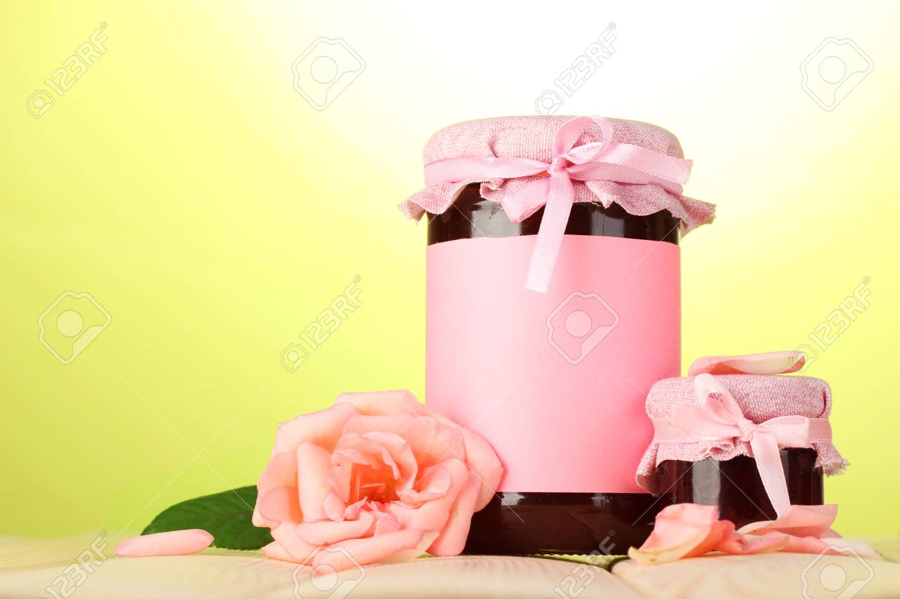 Jars With Rose Jam And Flower On Wooden Table On Green Background ...
