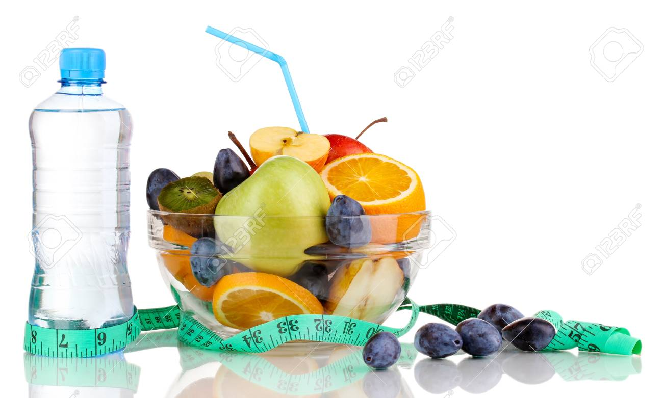 Glass bowl with fruit for diet, measuring tape and water bottle isolated on white Stock Photo - 16106747