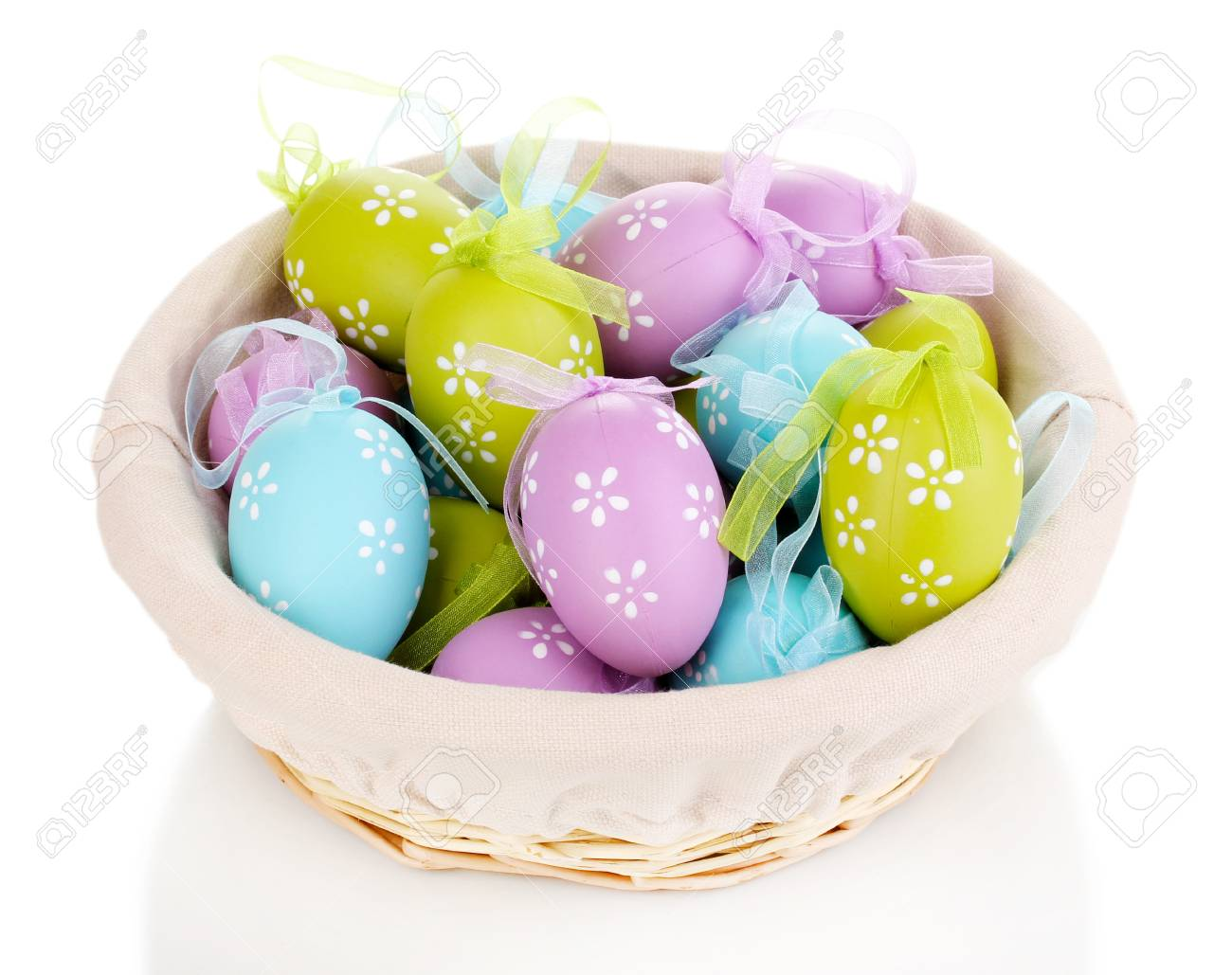 Colorful easter eggs in basket isolated on white Stock Photo - 16107615