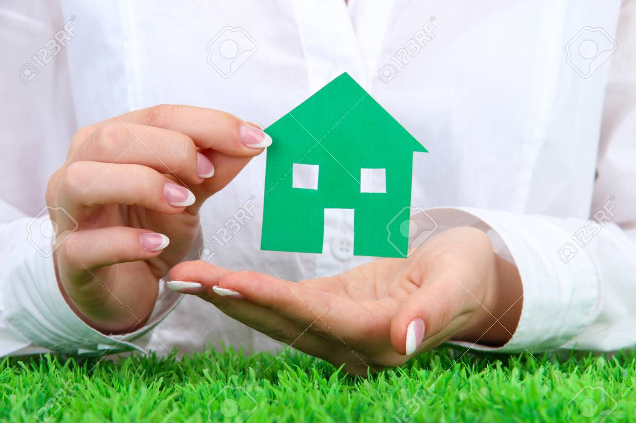 concept: woman hands with paper house, close up Stock Photo - 16195708