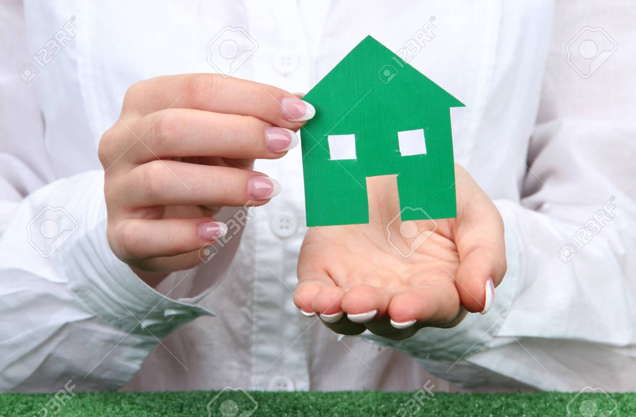 concept: woman hands with paper house, close up Stock Photo - 16277823