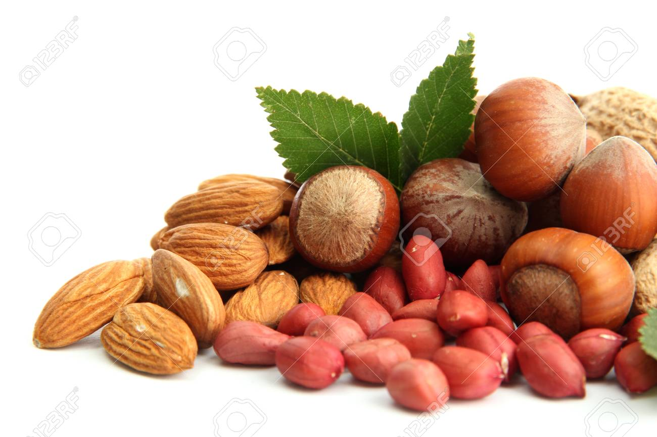assortment of tasty nuts with leaves, isolated on white Stock Photo - 16282196