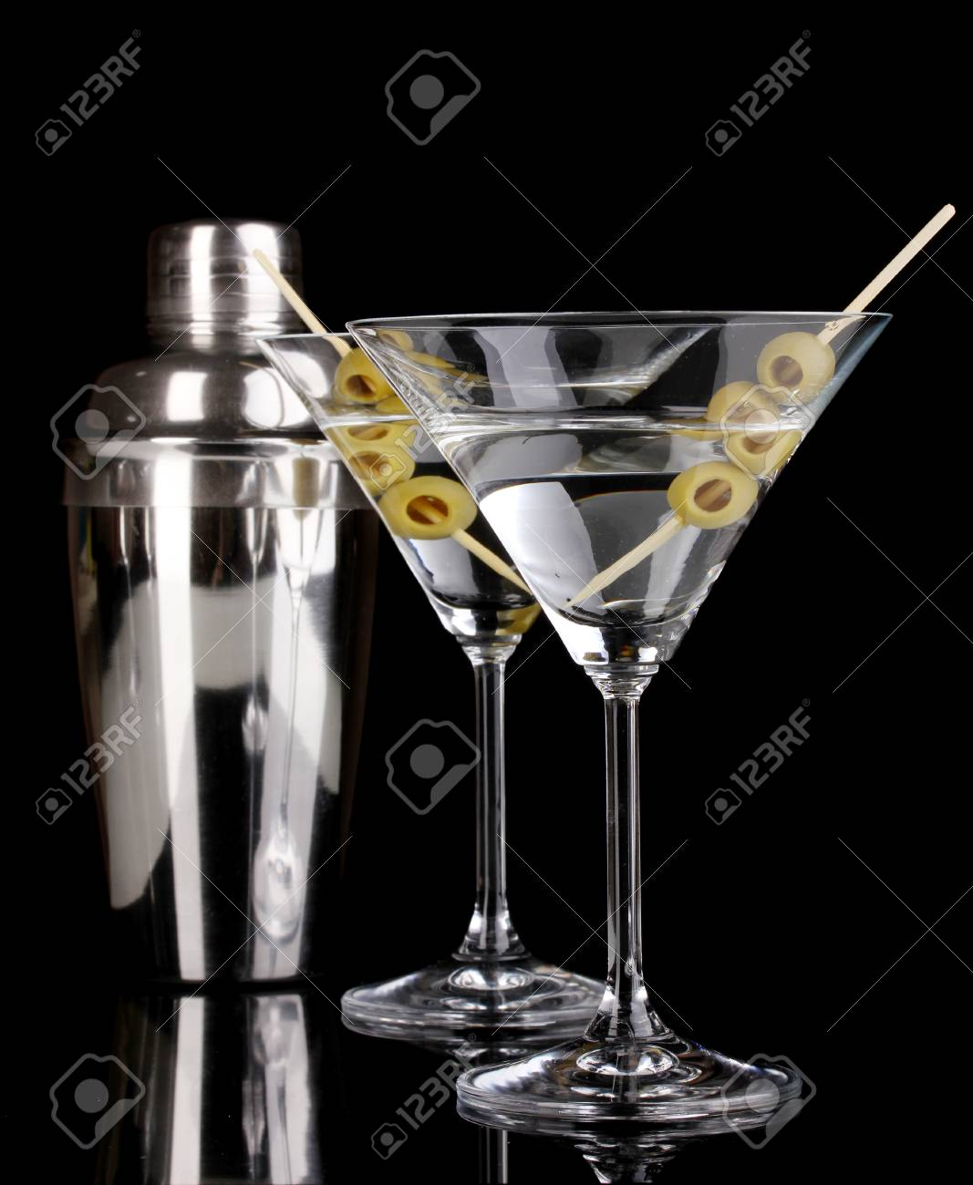 Martini glass with olives and shaker isolated on black Stock Photo - 16342367