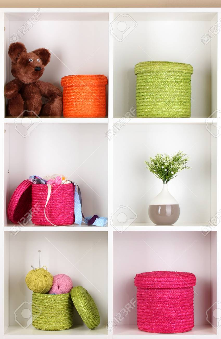 Color wicker boxes on cabinet shelves Stock Photo - 16342748